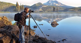 Photographer at Sparks Lake at sunrise near city of Bend,Central Oregon, USA
